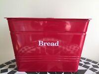 Red metal bread bin