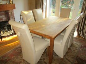 Solid wood six to eight-seater extendable dining table