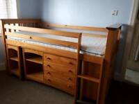M&S Solid Pine Cabin bed with pull out desk, shelves with 4 drawers and cupboard.