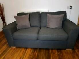 Hardly used 2x2 black fabric couches