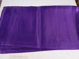 Purple satin table runners