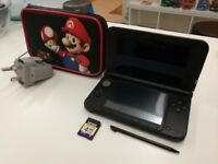 Nintendo 3DS XL Black and Silver with case and accessories.