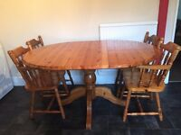 GENUINE WOOD OVAL KITCHEN/DINING TABLE AND FOUR CHAIRS