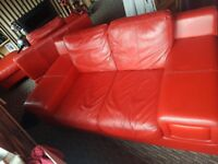 Red sofa and chair and foot stool