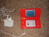 NINTENDO DSI IN RED WITH GAMES