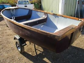 grp dinghy on road trailer