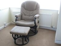 An upholstered high backed, rocking and swivel chair and rocking footstool. Very comfortable.