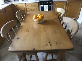 Solid pine table and four chairs.