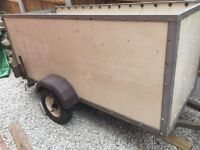 Trailer with drop down rear door.