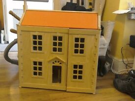 Wooden doll's house in good condition with original furniture
