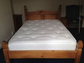 Wooden double bed with mattress wooden wardrobe and two wooden drawer units