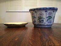 Vintage planter and base with a lovely floral design in blues and pink