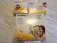 Medela Swing Electric Breastpump (used once), unused bottles and breast pads