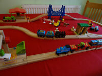 A Wooden Train Layout with many different pieces