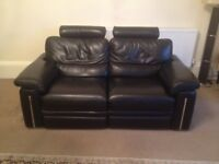 Leather reclining sofa for sale.