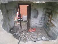 Free rubble, shed being removed.