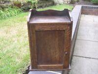 A small vintage oak wall cupboard.