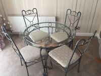 Glass Dining Table, 4 Chairs and matching Coffee Table for sale