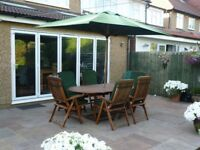 Solid wood garden table, 6 chairs and parasol