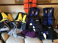 6 life jackets plus 1 dog life jacket