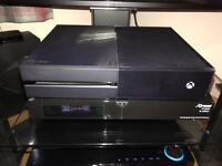 XBOX one console , with one wireless controller and all cables needed plus one Xbox one game