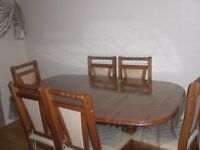 Sold Pine Dinning Table with 6 chairs and a middle extension