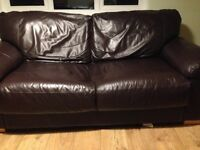 2 chocolate brown semi-aniline leather sofas and footstool