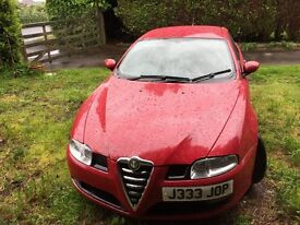 Red Alfa Romeo GT with cream leather interior