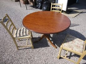 42 INCH WOODEN PEDESTAL TABLE AND 3 CHAIRS FOLDS FLAT FOR STORAGE