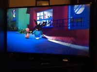 42 inch Panasonic flat screen, built in free view and stand