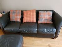 £80 Dark brown leather 3 seater sofa, chair and foot seat..With Cushions.