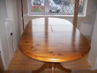 Pine extending dining table and six chairs