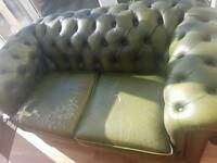 Two green sofas - three and two seater