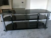Black and silver glass tv stand.