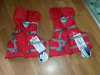 2 new never worn Stearns youth size life jackets