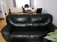 2 and 3 seater black real leather sofas