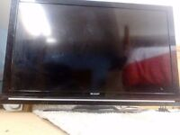 40 inch LCD Sharp TV and remote.