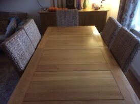 Beautiful oak dining table and rattan chairs