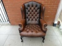 A Brown Leather Chesterfield Buttoned Queen Ann Armchair