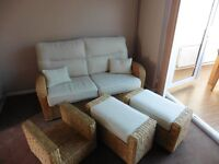Wicker 2 seater sofa bed, with coffee table and 2 storage stools, in cream, excellent condition