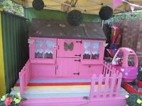 childs wooden play house and toys.