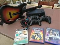 Playstation2 console with games and accessories
