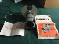 Slide and strip film projector - Hanimex as shown in photo. Includes handbook. £20