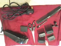 Hair clippers with guards and scissors and apron