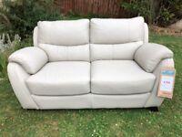 Brand New designer light grey leather 2 seater sofa £550 ono