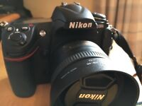 Nikon D300 Body with 35mm Lens and Battery power pack