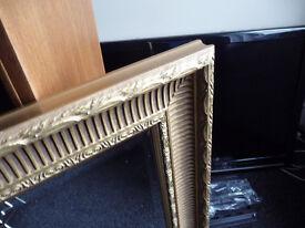 antique style gold surround mirror