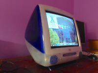 Apple iMac G3 Indigo M5521 running OS 9 and OS X.