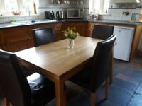 Habitat solid oak dining table and 6 chairs.