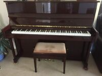 Upright Waldstein piano with stool